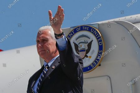 Vice President Mike Pence waves as he arrives at the 171st Air Refueling Wing base, in Imperial, Pa