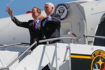 Vice President Mike Pence, right, and Sen. Pat Toomey, R-Pa., wave as they arrive at the 171st Air Refueling Wing base, in Imperial, Pa