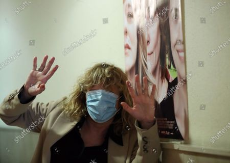 Emma Suarez, wearing a face mask, presents the movie 'Invisible' at the Renoir Plaza Espana cinema as it reopens doors in Madrid, Spain, 12 June 2020. Theaters in Madrid resumed business as lockdown restrictions are eased amid the ongoing pandemic of the COVID-19 disease caused by the SARS-CoV-2 coronavirus.