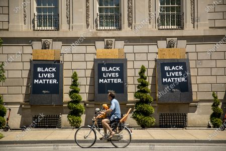 The words Black Lives Matter are painted on boarded up windows of the Hay Adams Hotel, a site of protests, near the White House in Washington. The protests began over the death of George Floyd, a black man who was in police custody in Minneapolis. Floyd died after being restrained by Minneapolis police officers