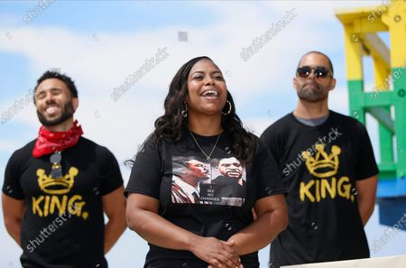 Lora King, Rodney King's daughter, middle, smiles as she attends a Black Lives Matter protest in the Venice Beach area of Los Angeles