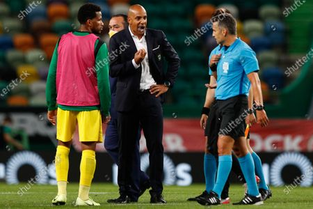 Stock Photo of Pacos Ferreira  head coach Pepa (C) talks with the referee Rui Costa (R) during the Portuguese First League soccer match between Sporting Lisbon and Pacos de Ferreira at Alvalade Stadium in Lisbon, Portugal, 12 June 2020.