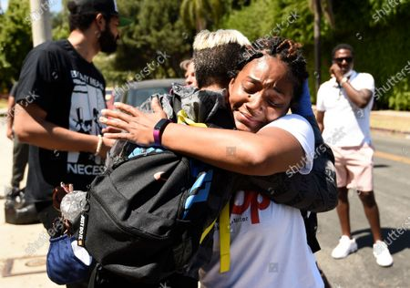 Stock Photo of Actor/comedian Tiffany Haddish, right, embraces Sibley Scoles after she addressed the crowd at the Stand-Up for Social Justice rally at the Laugh Factory Hollywood comedy club, in Los Angeles