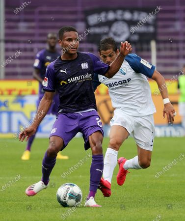Osnabrueck's Felix Agu (L) in action against Bochum's Cristian Gamboa (R) during the German Bundesliga Second Division soccer match between VfL Osnabrueck and VfL Bochum in Osnabrueck, Germany, 13 June 2020.