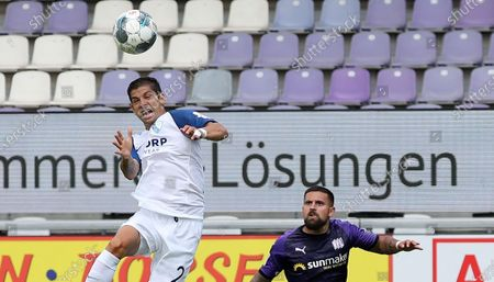 Stock Image of Osnabrueck's Marcos Alvarez (R) in action against Bochum's Cristian Gamboa (L) during the German Bundesliga Second Division soccer match between VfL Osnabrueck and VfL Bochum in Osnabrueck, Germany, 13 June 2020.