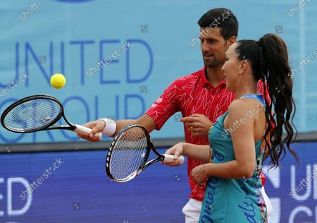 Stock Picture of Novak Djokovic (L) and Jelena Jankovic of Serbia react during an exhibition match prior to the  tennis tournament Adria Tour in Belgrade, Serbia on June 12, 2020.
