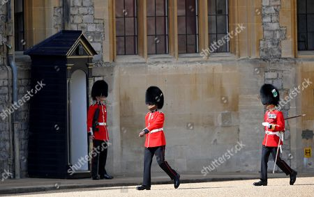 Members of the Household Division arrive in preparation for a ceremony to mark Britain's Queen Elizabeth's official birthday at Windsor Castle in Windsor, Britain, June 13, 2020. The Queen celebrates her 94th birthday this year.