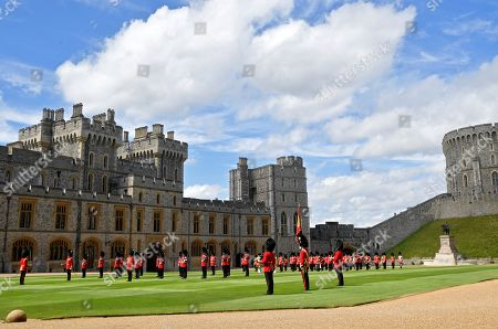 Guardsmen keep social distance as they stand in formation for a ceremony to mark Britain's Queen Elizabeth's official birthday at Windsor Castle in Windsor, Britain, June 13, 2020. The Queen celebrates her 94th birthday this year.