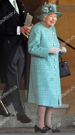 Britain's Queen Elizabeth II smiles towards the end of a ceremony to mark her official birthday at Windsor Castle in Windsor, Britain, June 13, 2020. The Queen celebrates her 94th birthday this year.