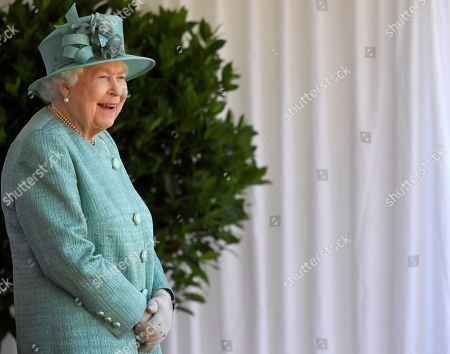 Britain's Queen Elizabeth II attends a ceremony to mark her official birthday at Windsor Castle in Windsor, Britain, June 13, 2020. The Queen celebrates her 94th birthday this year.