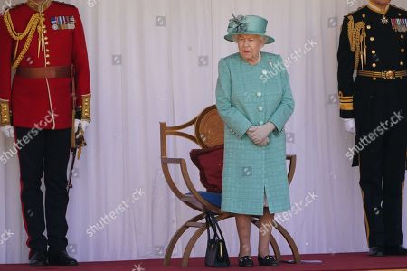 Queen Elizabeth II viewing a military parade Windsor castle to mark Her Majesty's Offical Birthday.