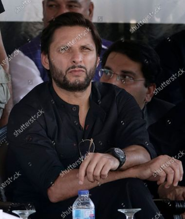 Pakistan's former cricketer Shahid Afridi attend a ceremony in Muzaffarabad, capital of Pakistani Kashmir. Pakistan's celebrated allrounder Afridi has tested positive for COVID-19. Afridi said in a tweet that his body had been aching since Thursday and he has been tested positive on