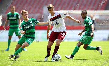 Patrick Erras (C) of 1. FC Nuernberg is challenged by Sebastian Ernst (L) and Julian Green of SpVgg Greuther Fuerth during the German Bundesliga Second Division match between 1. FC Nuernberg and SpVgg Greuther Fuerth at Max Morlock stadium in Nuremberg, Germany, 13 June 2020.