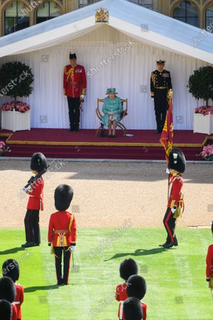 Queen Elizabeth II views a military ceremony in the Quadrangle of Windsor Castle to mark Her Majesty's Official Birthday on Saturday 13th June, 2020. The ceremony will be executed by soldiers from the 1st Battalion Welsh Guards, who are currently on Guard at Windsor Castle, and feature music performed by a Band of the Household Division.