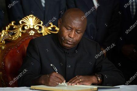 Burundi's president-elect Evariste Ndayishimiye signs the book of condolences at the presidential palace in Bujumbura, Burundi . Burundi's constitutional court on Friday said president-elect Evariste Ndayishimiye should be sworn in as soon as possible, ending uncertainty created by the death of President Pierre Nkurunziza this week