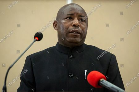 Burundi's president-elect Evariste Ndayishimiye speaks to the media after signing the book of condolences at the presidential palace in Bujumbura, Burundi . Burundi's constitutional court on Friday said president-elect Evariste Ndayishimiye should be sworn in as soon as possible, ending uncertainty created by the death of President Pierre Nkurunziza this week