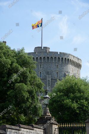The large ceremonial Royal Standard was flying on the Round Tower at Windsor Castle today. A private mini Tropping the Colour Parade was held in the Quadrangle at Windsor Castle to celebrate the official birthday of Queen Elizabeth II