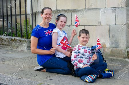 Stock Picture of Royal fans Mum Helen Lawes and her children Maddie and Harrison came into Windsor today to hear the mini Tropping the Colour Parade held in the Quadrangle at Windsor Castle to celebrate the official birthday of Queen Elizabeth II
