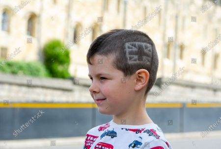 Harrison Lawes has a special Union Jack hair cut by his Mum Helen before he arrived in Windsor today to hear the mini Tropping the Colour Parade held in the Quadrangle at Windsor Castle to celebrate the official birthday of Queen Elizabeth II
