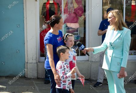 Mum Helen Lawes and her children Maddie and Harrison get interviewed by as they came into Windsor today to hear the mini Tropping the Colour Parade held in the Quadrangle at Windsor Castle to celebrate the official birthday of Queen Elizabeth II