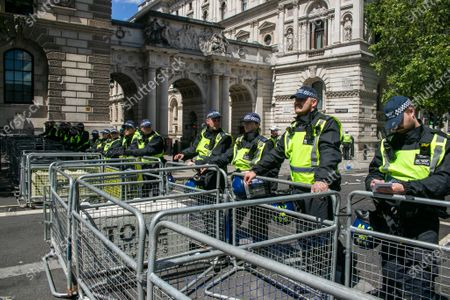 Riot police on standby as hundreds of  far-right activists gather around the Winston Churchill statue in Parliament Square which was covered up to protest after several statues were damaged during Black Lives Matter demonstrations.