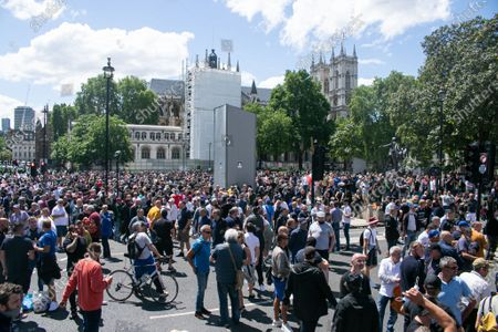Hundreds of  far-right activists gather around the Winston Churchill statue in Parliament Square which was covered up to protest after several statues were damaged during Black Lives Matter demonstrations.