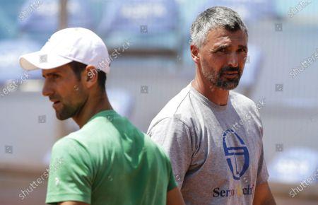 Croatia's Goran Ivanisevic (R), the coach of Serbia's Novak Djokovic (L), reacts prior to the start of the Adria Tour tennis tournament in Belgrade, Serbia, 13 June 2020. The Adria Tour will be held until 05 July in Serbia, Croatia, Montenegro and Bosnia.