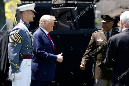 Stock Picture of Cadet Daine Van De Wall stands next to President Donald Trump and Superintendent of the United States Military Academy Lt. Gen. Darryl Williams after West Point Class of 2020 commencement ceremonies on the parade field, at the United States Military Academy in West Point, N.Y