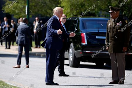 President Donald Trump greets Superintendent of the United States Military Academy Lt. Gen. Darryl Williams at the United States Military Academy in West Point, N.Y