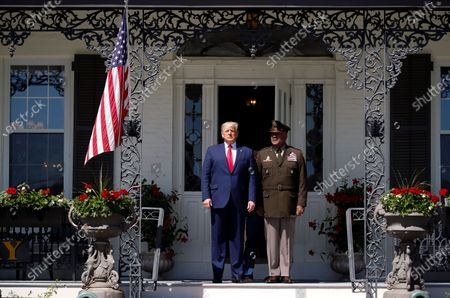 President Donald Trump walks out of the Superintendent's House accompanied by Superintendent of the United States Military Academy Lt. Gen. Darryl Williams, to speak to over 1,110 cadets in the Class of 2020 at a commencement ceremony on the parade field, at the United States Military Academy in West Point, N.Y