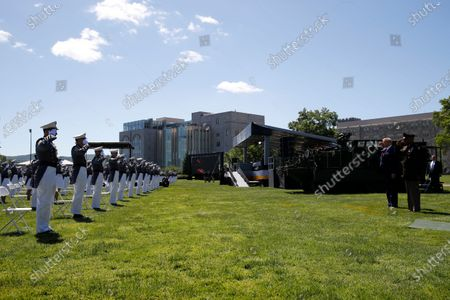 President Donald Trump, second from right, and Superintendent of the United States Military Academy Lt. Gen. Darryl Williams, right, salute cadets prior to speaking to the Class of 2020 at a commencement ceremony on the parade field, at the United States Military Academy in West Point, N.Y