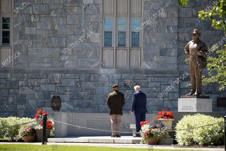 President Donald Trump and Superintendent of the United States Military Academy Lt. Gen. Darryl Williams visit a statue to Gen. Douglas MacArthur prior to Trump speaking to over 1,110 cadets in the Class of 2020 at a commencement ceremony on the parade field, at the United States Military Academy in West Point, N.Y