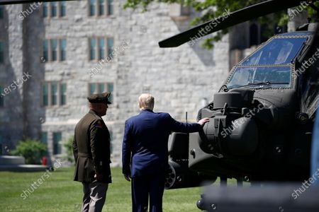 President Donald Trump, right, looks over a helicopter with United States Military Academy Lt. Gen. Darryl Williams, prior to a commencement ceremony on the parade field, at the United States Military Academy in West Point, N.Y