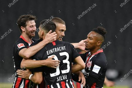 Frankfurt's Portuguese forward Andre Silva (2-L) celebrates with teammates David Abraham (L), Stefan Ilsanker (2-R) and Jonathan de Guzman (R) after scoring the team's fourth goal during the German Bundesliga soccer match between Hertha BSC and Eintracht Frankfurt at the Olympic stadium in Berlin, Germany, 13 June 2020.