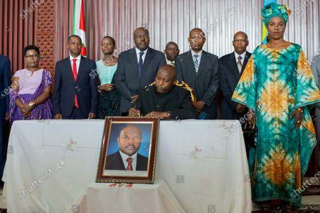 "Burundi's president-elect Evariste Ndayishimiye (C, front) signs a condolence book for Burundian president Pierre Nkurunziza who passed away recently in Bujumbura, Burundi, on June 13, 2020. Burundian Constitutional Court on Friday announced the swearing-in of the Ndayishimiye ""as soon as possible"", after the death of Nkurunziza on Monday."