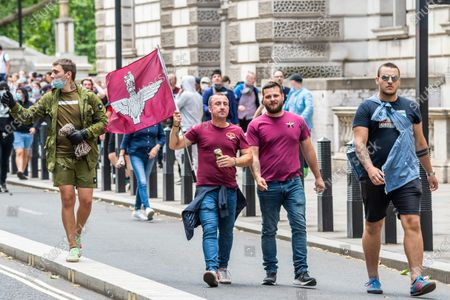 Protesters, a mixed group of Tommy Robinson fans, football supporters and veterans meet to complain about the damage to statues, such as Churchills, by a minority of the Black Lives Matter protest a week ago.