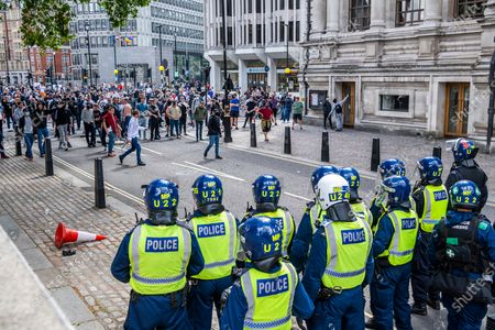 Stock Photo of Protesters, a mixed group of Tommy Robinson fans, football supporters and veterans meet to complain about the damage to statues, such as Churchills, by a minority of the Black Lives Matter protest a week ago.