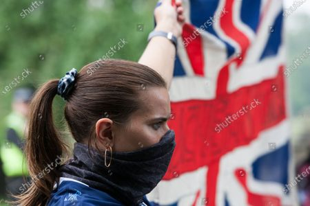 An anti-racism protester holds up a Union Flag in Huddersfield.