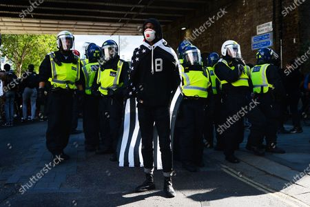 A protester from an anti-racist demonstration in front of police, Waterloo.