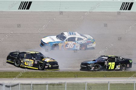 Alex Labbe (36) passes Brett Moffitt (02) and Vinnie Miller (78) after a collision during a NASCAR Xfinity Series auto race, in Homestead, Fla