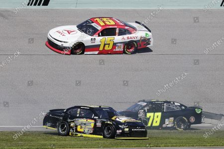Colby Howard (15) passes Brett Moffitt (02) and Vinnie Miller (78) after a collision during a NASCAR Xfinity Series auto race, in Homestead, Fla