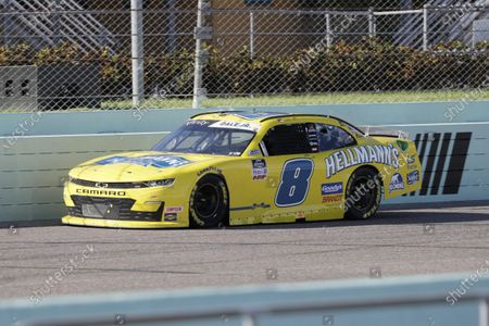 Dale Earnhardt Jr. (8) drives during a NASCAR Xfinity Series auto race, in Homestead, Fla