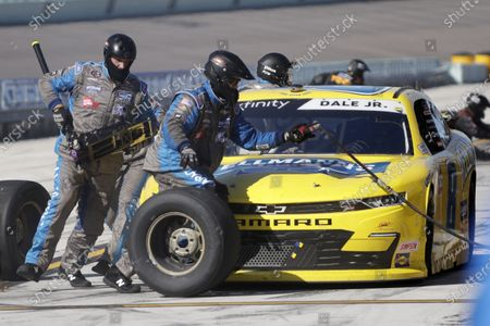 Stock Photo of Dale Earnhardt Jr. makes a pit stop during a NASCAR Xfinity Series auto race, in Homestead, Fla