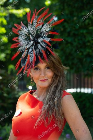 Stock Photo of Milliner Ilda di Vico wears an orange dress and striking headpiece to Day 5 of Royal Ascot