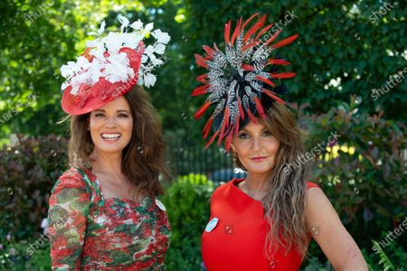 Milliner Ilda di Vico (right) wears an orange dress and striking headpiece to Day 5 of Royal Ascot