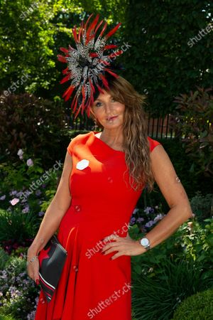 Stock Picture of Milliner Ilda di Vico wears an orange dress and striking headpiece to Day 5 of Royal Ascot