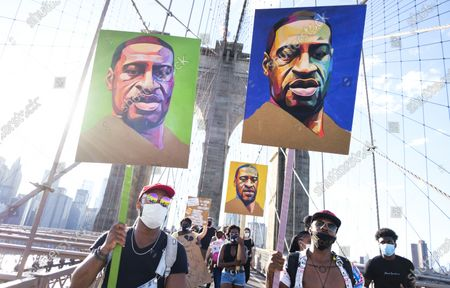 People march over the Brooklyn Bridge during a Black Lives Matter protest against police brutality as part of the larger public response to the recent death of George Floyd, an African-American man who died while in the custody of the Minneapolis police, in New York, New York, USA, 13 June 2020. There have been wide spread protests following Floyd's death, which was captured in a cell phone video where a police officer, who has now been charged with murder, is kneeling on Floyd's neck while he is saying 'I can't breathe'.