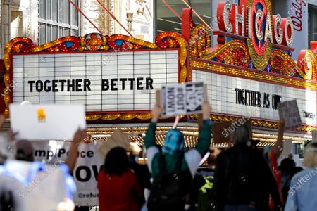 Demonstrators walk on State street during the Chicago March for Justice in honor of George Floyd, in downtown Chicago. Protests in Chicago continued for the third weekend in a row Saturday following the death of George Floyd