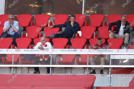 Uli Hoeness (front C), Honorary President of FC Bayern Munich and Herbert Hainer (front, C), President of FC Bayern Munich, watch the Bundesliga match between FC Bayern Munich and Borussia Moenchengladbach at Allianz Arena in Munich, Germany, 13 June 2020 (issued 14 June 2020).