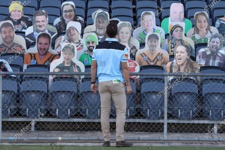Cronulla Sutherland Sharks coach John Morris inspects carboard cutouts of supporters ahead of Round 5 of the Australian Rugby League (ARL) match between the St. George Illawarra Dragons and the Cronulla Sutherland Sharks at Campbelltown Stadium in Sydney, Australia, 14 June 2020. Matches are being held behind closed doors to prevent further spread of COVID-19.